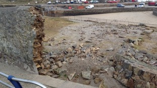 Damage to Portreath Harbour wall as seen from above.