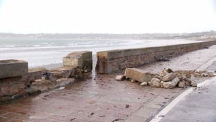 Part of the sea wall on Victoria Avenue in St Helier has been damaged in storms