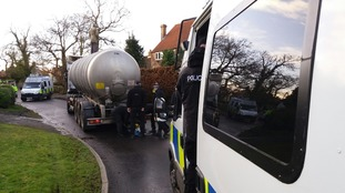 Three people have been arrested after climbing on top of a truck in Kirby Misperton as part of anti-fracking protests.