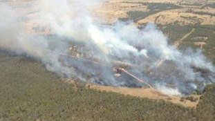 A bushfire gathers momentum to the west of Sydney.