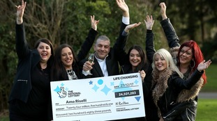 Amo Riselli adn his family celebrate as he wins nearly £25 million.