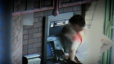 Criminal gang tamper with an ATM machine