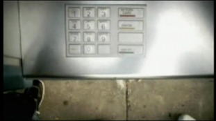 Still from a footage filmed on a secret camera installed on a cash machine