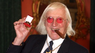 Jimmy Savile collecting an award in 2008.
