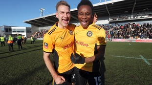 Newport County's Mickey Demetriou (left) and Shawn McCoulsky celebrate victory after the Emirates FA Cup, Third Round match