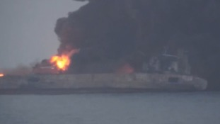 Spilling oil tanker at risk of blowing up as gases hamper hunt for crew