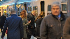 Commuters board a Greater Anglia train at Shenfield in Essex, as workers in five rail companies stage a fresh wave of strikes.