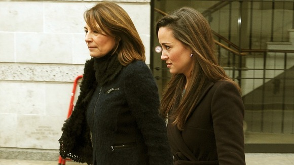 The mother and sister of the Duchess of Cambridge, Carole (left) and Pippa, leave the National Portrait Gallery in central London, after viewing the new portrait of her by Paul Emsley.