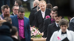 Jodie's widower Malcolm (back right) helps to carry her coffin