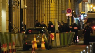 French police attend the scene outside the Ritz Hotel in Paris, France.