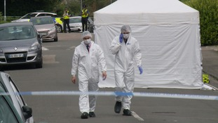 Forensic officers at the murder scene in June 2017