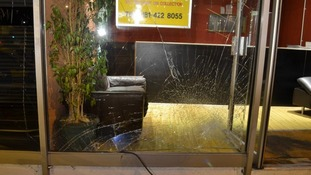 The smashed window of Spicy Night.