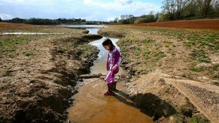 Five-year-old Isla Stanton paddling in Bewl Water Reservoir near Lamberhurst, Kent, which is currently standing at 49% of its capacity.