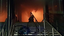 A firefighter tackles the blaze early on Friday morning.