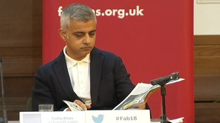 Sadiq Khan caught up with the news while he waited for police to clear the protesters.