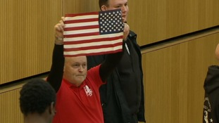 One member of the White Pendragons group held aloft an American flag in apparent solidarity with Donald Trump.