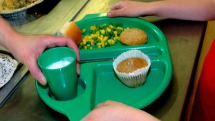 A school pupil receives a school meal
