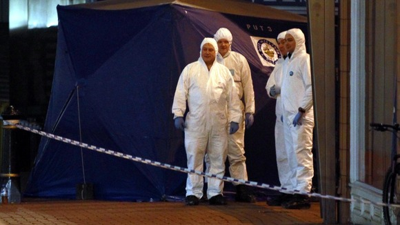 Police look for evidence at the scene of the Birmingham city centre stabbings.