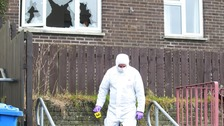 Forensic officer at the scene of the shooting in which 2 men escaped injury.