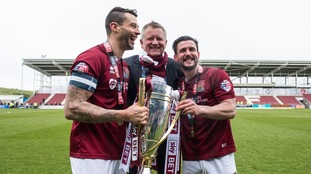 Marc Richards (left) poses with the League Two trophy in 2016.