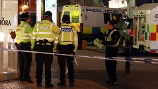 A man was arrested shortly after the two victims were stabbed in Birmingham city centre.