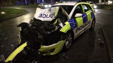The wreckage of the police car.