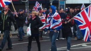 Around a thousand Loyalists march to Belfast City Hall to protest.