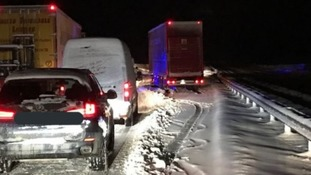 Hundreds of drivers trapped overnight as heavy snow hits UK