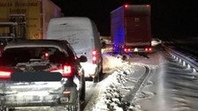 Tailbacks built up on the snow-hit M74 motorway from late Tuesday