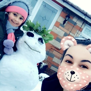 Níamh and Tara having fun in the snow in Newtownabbey.