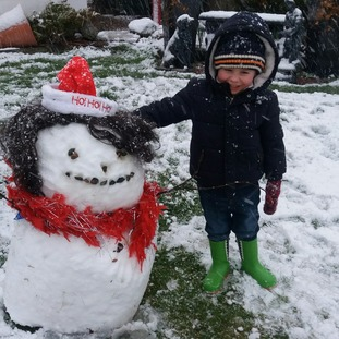Kian Campbell in Banbridge with his snow girl.