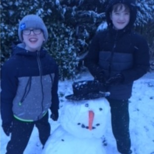 Gerard and Aaron enjoying the snow after getting home early in Banbridge.