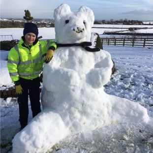 Calum Rice, aged 11, with a giant snow bear in Castlewellan, Co Down.