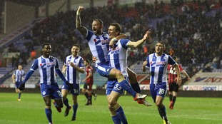 FA Cup: League One Wigan thrash Bournemouth