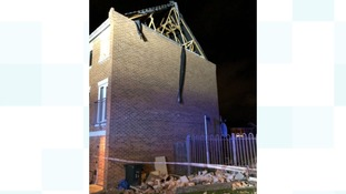 Gable end of a roof blown away due to strong winds