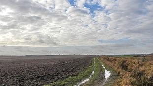 Cloud breaking over a field