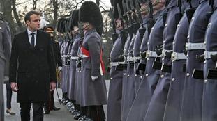 President Macron observes a guard of honour at Sandhurst.