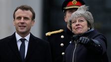 May and Macron meet for talks on migrants and defence