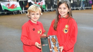 A Welsh lovespoon was presented to the couple by Harry and Megan from Marlborough Primary School in Cardiff.
