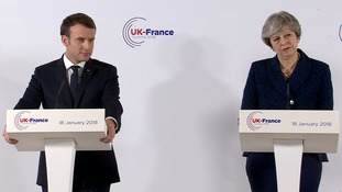 Theresa May and Emmanuel Macron hold talks on migrants and defence