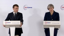 May and Macron hold talks on migrants and defence