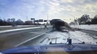 Mechanic in remarkable near miss with skidding car