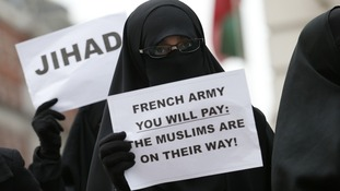 Islamists protest outside the French Embassy in London