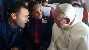 Pope Francis marries cabin crew couple on flight over Chile