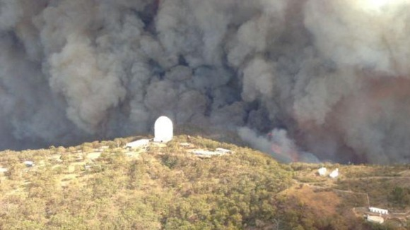 The remote mountaintop facility engulfed in smoke on Sunday.
