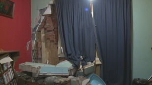 The damage caused to the front room of the house