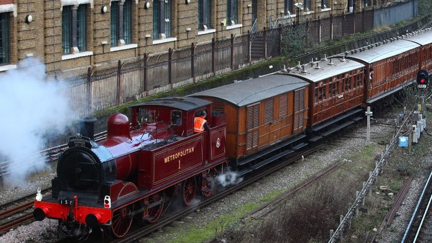 A restored steam train beginning its journey from to Moorgate, as part of the London Underground's 150th anniversary celebrations.