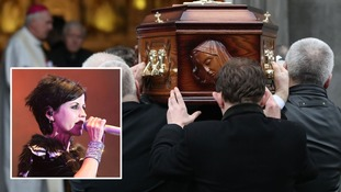 Fans gather to pay tribute to Cranberries singer as her coffin arrives at church service