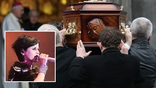 Dolores O'Riordan's coffin is carried into St Joseph's Church in Limerick.