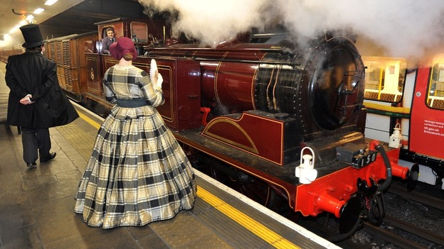 Passengers dressed in period costume prepare to board the restored Metropolitan Railway carriage No 353.